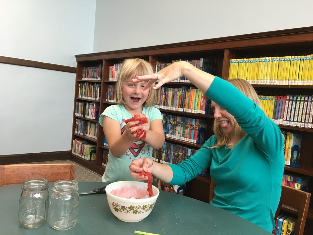 Librarian Melissa Lupino makes slime with local children during the library's Summer Reading Program.